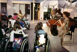 Children are transfixed by the music of Kim Gilad at Children's Hospital of Los Angeles