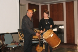 Pepe Santana demonstrates the use of a drumlin his music of the Andes at a conference